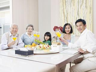 happy asian family toasting and celebrating