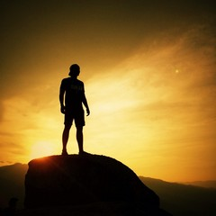 silhouette of man on sunrise background