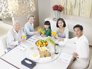 happy asian family dining at home