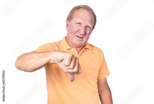 Handsome old man in orange polo-shirt shows thumb down