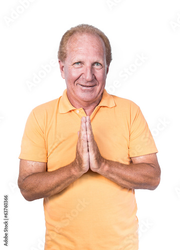 Handsome old man in orange polo-shirt doing Thai gesture or begg
