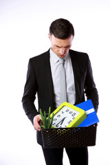 You are fired! Businessman hold box with personal belongings