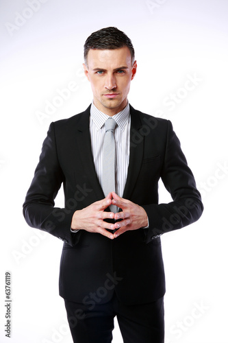 Professional businessman standing on a gray background