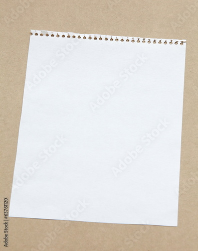 white blank note paper on brown background
