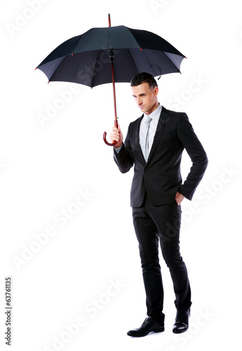 portrait of a businessman holding umbrella