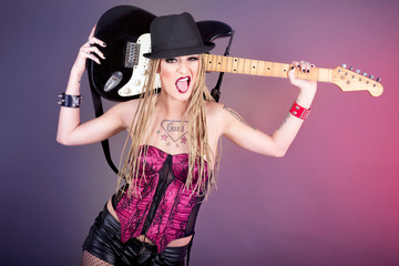 Beautiful woman punk rocker with electric guitar