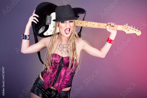 Beautiful woman punk rocker with electric guitar