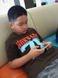 boy play game on smartphone