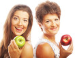 canvas print picture - mature mother and yung daughter with apples