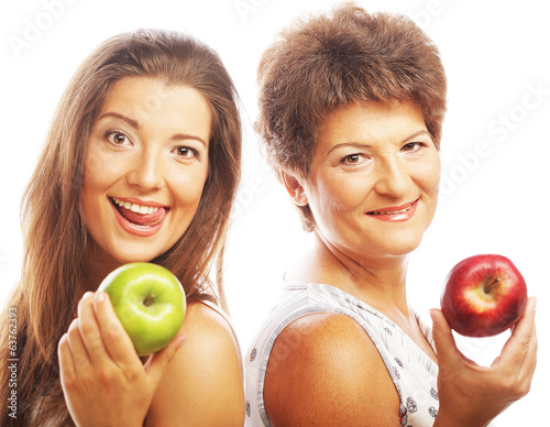 mature mother and yung daughter with apples