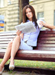 canvas print picture - Businesswoman sitting on park bench