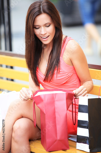Surprised young woman with shopping bags