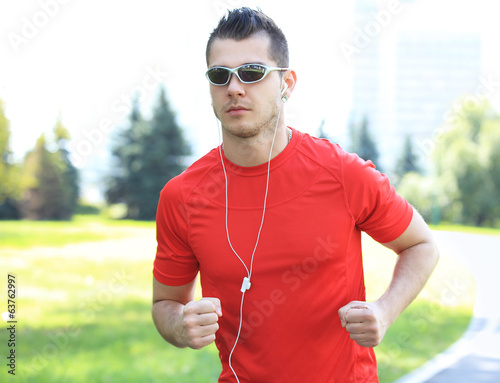 Sport - Runner. Man running with concentration
