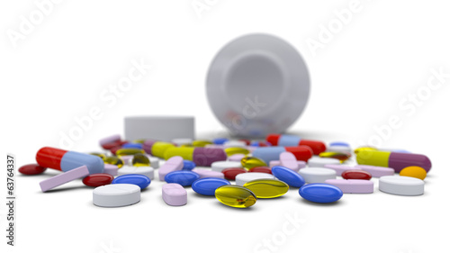 Colorful pills spilled from bottle