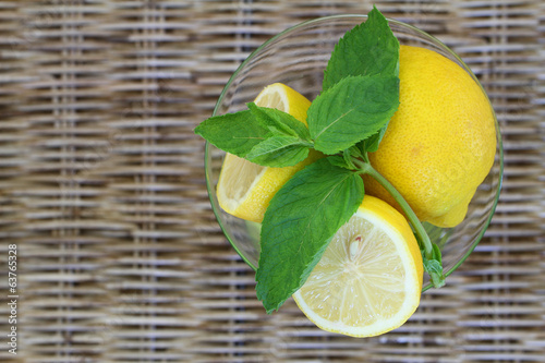 Lemon and mint on wicker with copy space