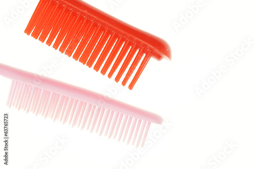 Pink and red comb different size isolated