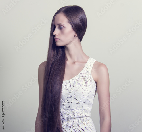 Portrait of a beautiful young woman with long hair.