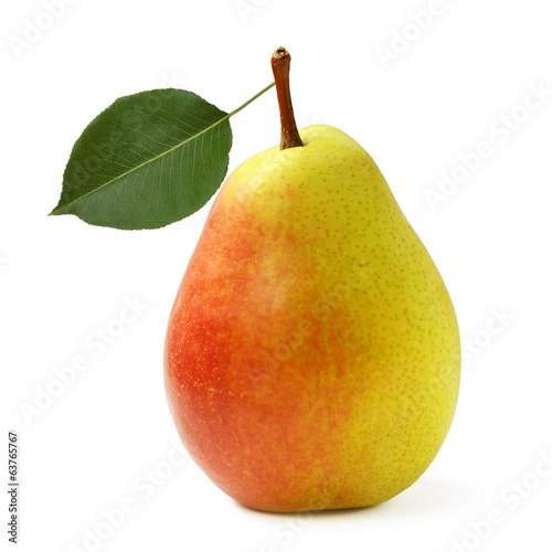 Ripe yellow pear with leaf isolated on white