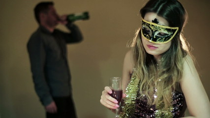 drunk woman in a mask with a glass of wine  and a drunk man in t