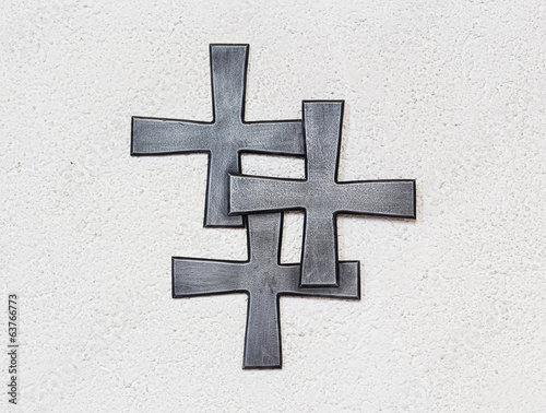 Three crosses on the wall of a church.