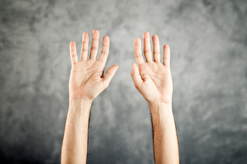 Caucasian Open hands raised for surrender