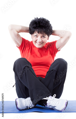 Middle-aged woman doing sit-ups