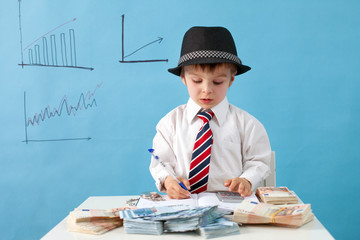 Young boy, counting money and taking notes