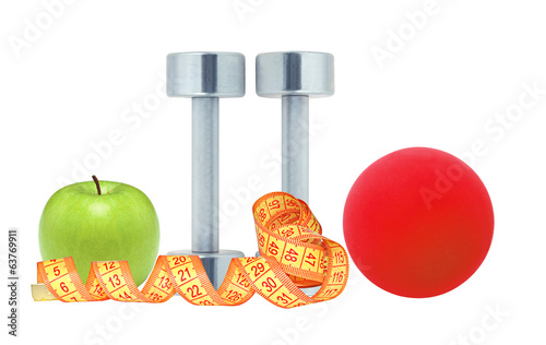 Chromed fitness dumbbells, measure tape red ball and green apple