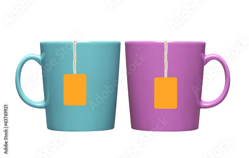 Two cups and tea bags with orange label isolated on white