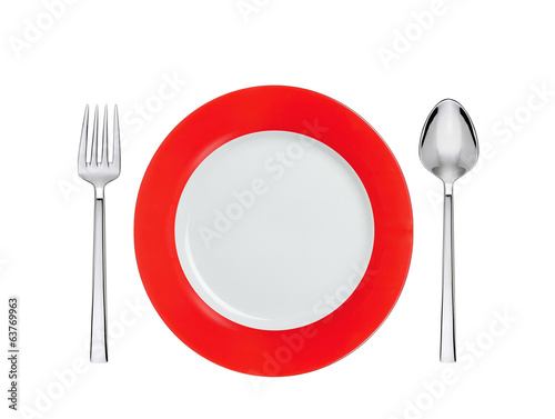 Knife, red and white plate and fork, isolated on white
