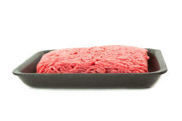 A tray of fresh lean ground beef from supermarket isolated on wh