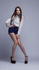 full-length portrait of beautiful brunette woman. Fashion shot