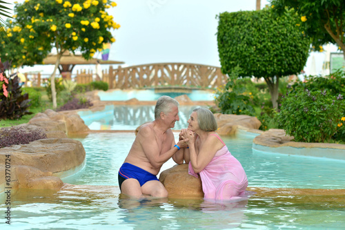 Couple relaxing at pool