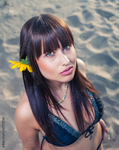 Beautiful young woman in summer nature lifestyle portrait.