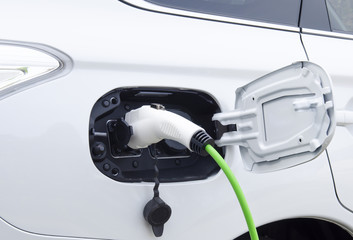 Electric car charged. Charging an electric whitte car connected