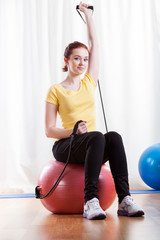 Woman practising at fitness room
