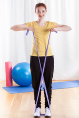 Woman practising arm muscles