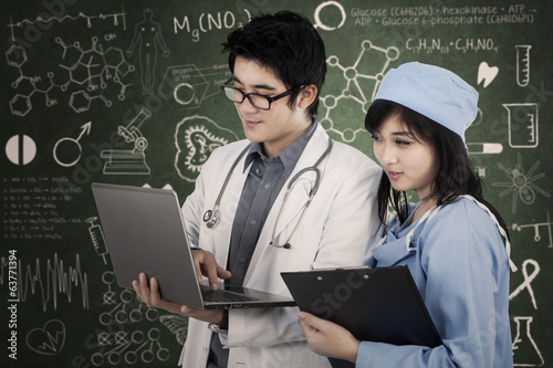 Doctor and nurse working at laboratory