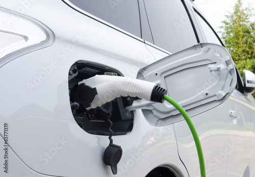 Electric Car Being Charged Poster