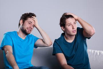 Men friends watching match