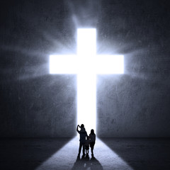 Family walks towards a Cross