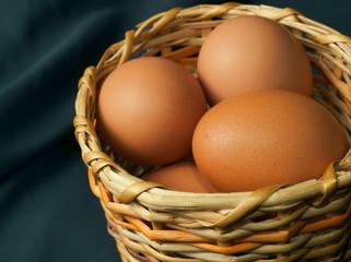 Chicken eggs in a wicker basket