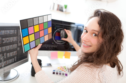 Woman photographer calibrate her screen