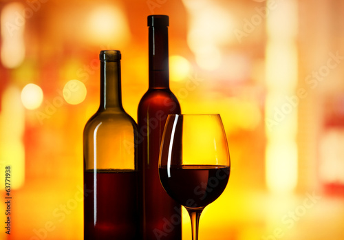 bottles and glass with  wine