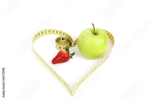 green apple with a measuring tape and heart symbol isolated