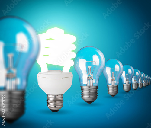 Idea concept with light bulbs on blue