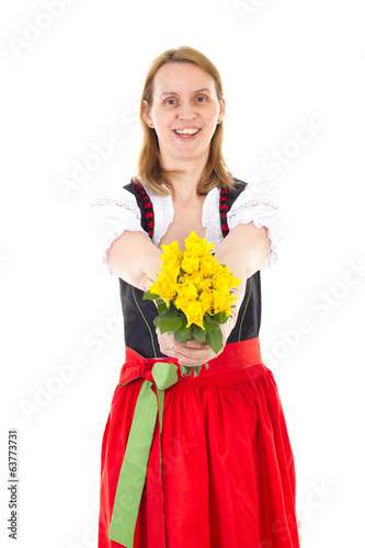 Beautiful woman in dirndl giving bunch of roses