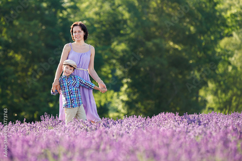 Woman and her little son in lavender field