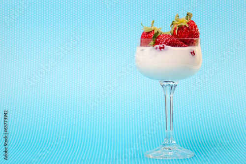 fresh strawberries on a glass with cream
