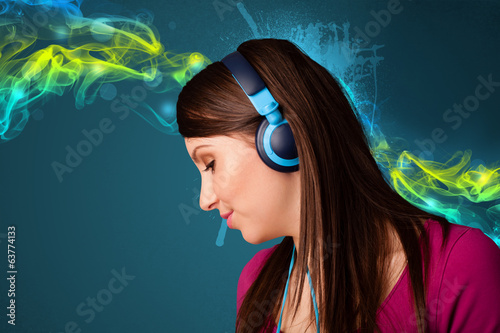 Young woman listening to music with headphones